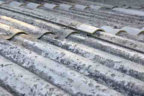Close up of asbestos roofing that requires specialist removal